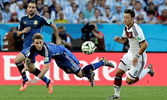 Argentina's Lucas Biglia heads away against Germany